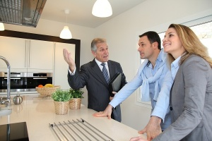 buyers looking at kitchen in home