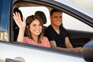 woman waving out car window