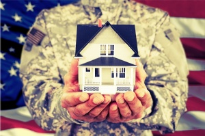 soldier holding small model house