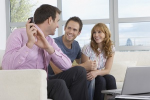 real estate agent holding phone