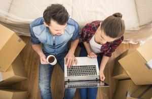 couple sitting among moving boxes