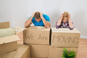 stressed couple with moving boxes