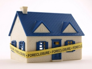home with foreclosure tape