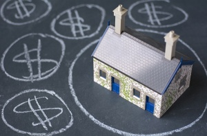 house on chalkboard with dollar signs