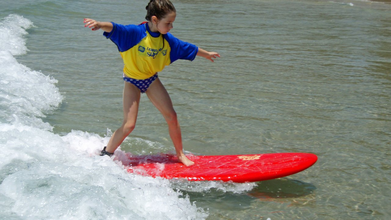 Surfing in a fun and safe environment with Port Macquaries award winning surf school