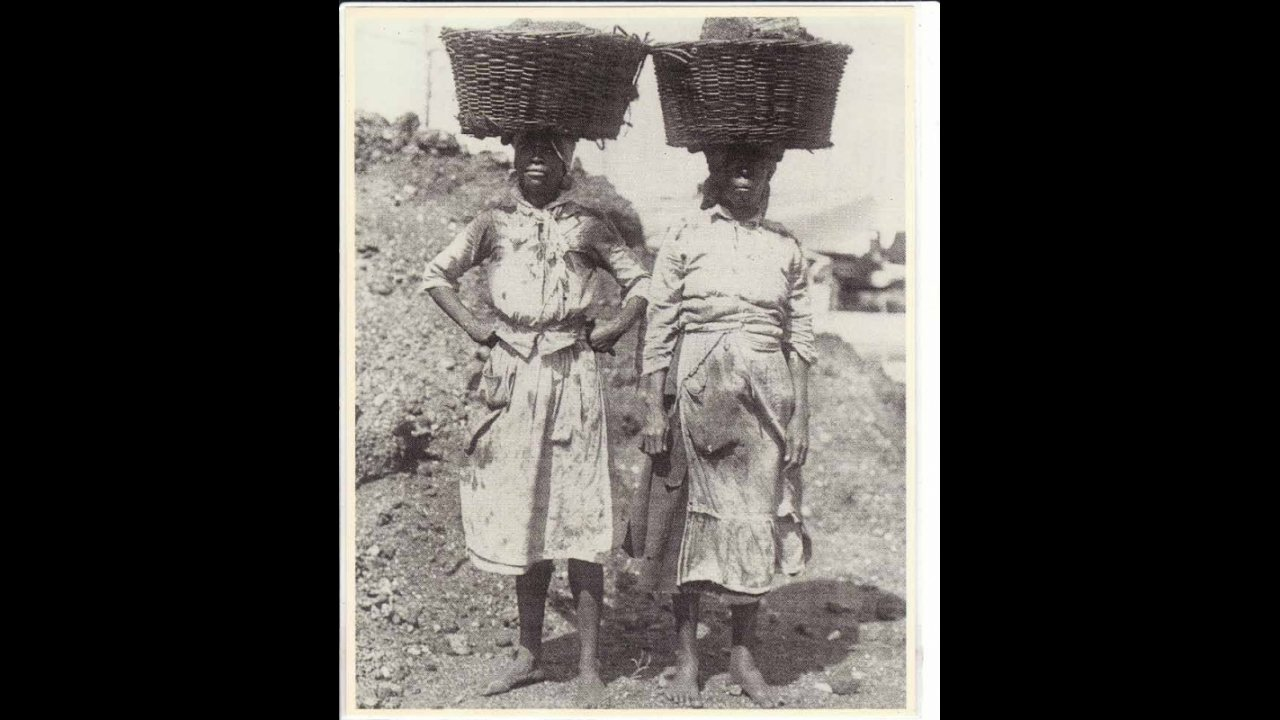 Women carrying coal on their heads.