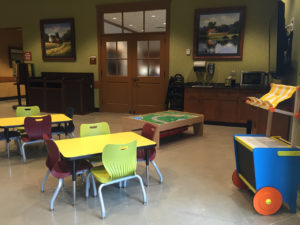 The kids' play area is nestled in the family café space.