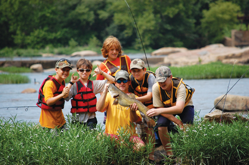 "Tee Clarkson, founder of Richmond-based outdoor camp Virginia Outside, says, ""A lot of families may not know exactly how to get their kids out fishing or mountain biking, so we like to create those opportunities."""