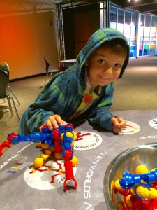 Real mom Fiona's real RVA kid enjoying a robot-building station.