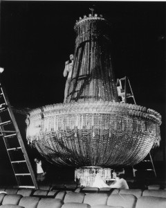 An 18-foot, two-and-a-half ton Czechoslovakian crystal chandelier is installed prior to the Byrd Theatre's 1928 Christmas Eve opening.