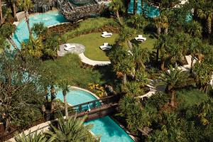 Visitors enjoy a conference center, spa, fitness center, and tennis courts, along with a 5-acre water park and playground, featuring the popular Kid for All Seasons program for children.