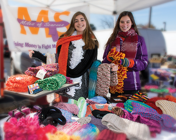 Meredith Polk, right, is shown here with Emily Harrison, a fellow philanthropist. The efforts of Miles of Scarves, founded by Meredith, have resulted in more than $22,000 for MS.
