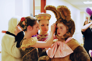 School of Richmond Ballet students apply finishing touches as they prepare to take the stage as Dolls in the Battle scene of The Nutcracker.
