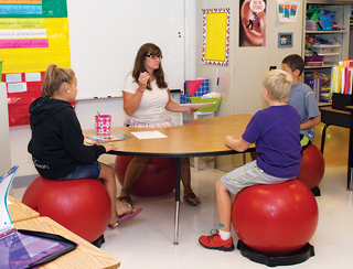 The teachers say sitting on the balance balls can help children stay focused and on-task in a classroom setting.