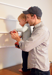 John and Clara work on a DIY project that might be featured on the Petersiks' wildly popular blog, Young House Love.