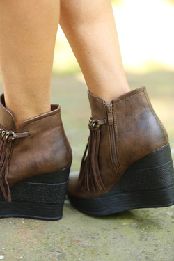 c53d49c8c4e Wedge booties that feature a chain and fringe detail for vintage appeal.  Synthetic upper (genuine suede fringe detail)