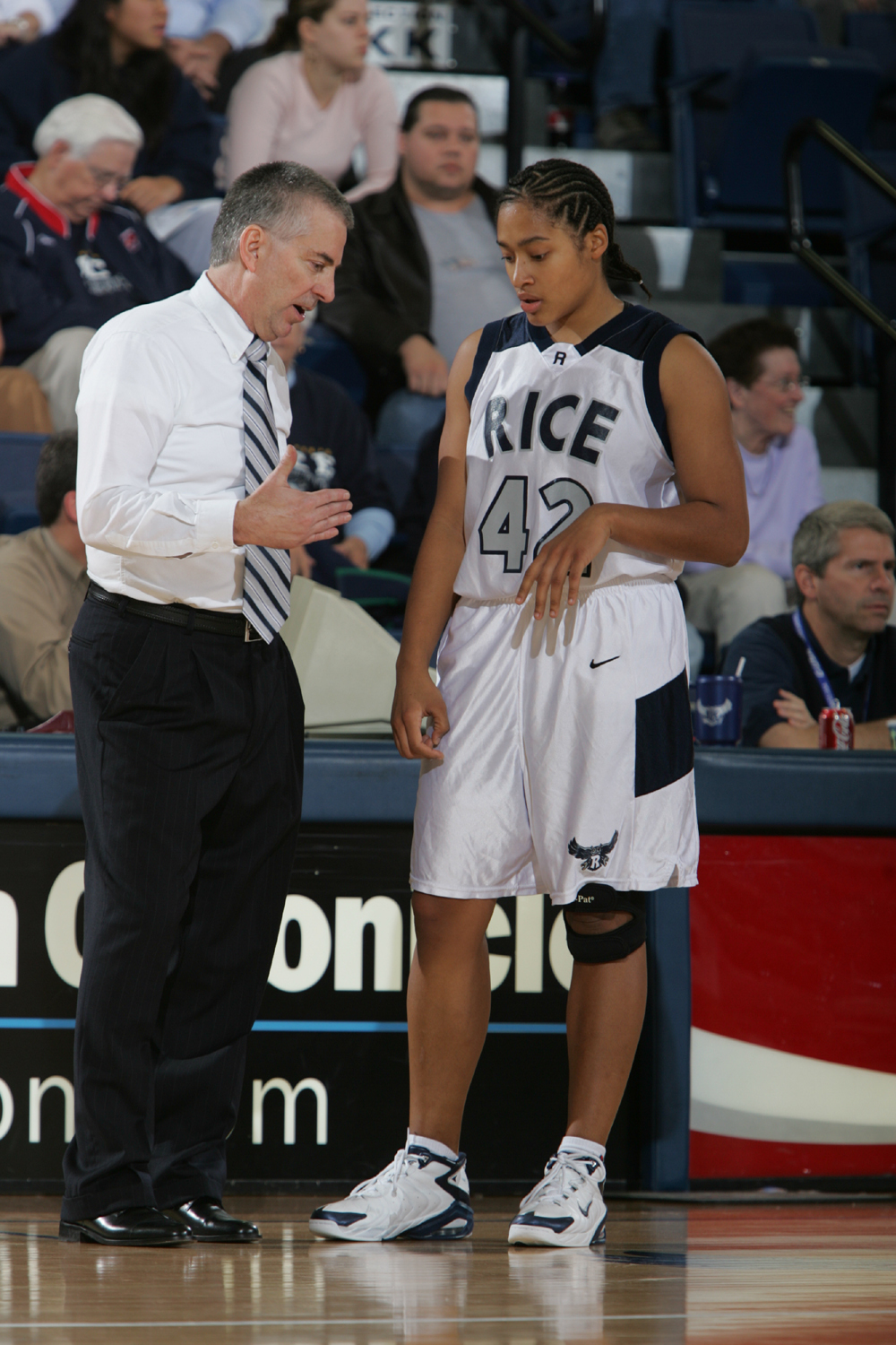 Greg Williams discusses strategy with guard Amber Cunningham