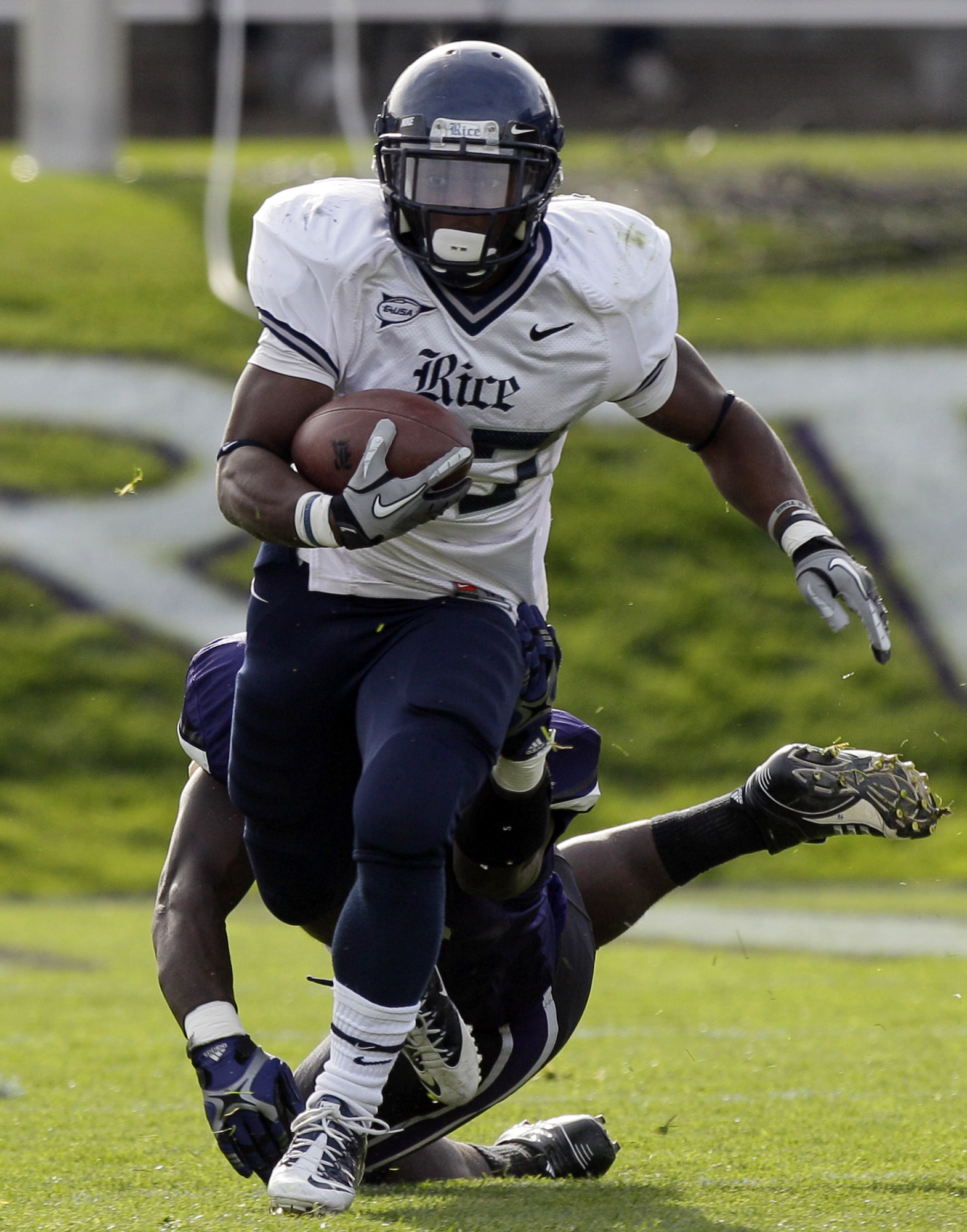 Rice running back Tyler Smith, who had 84 yards on a season-high 21 carries, runs past Northwestern linebacker Damien Proby in the first half.