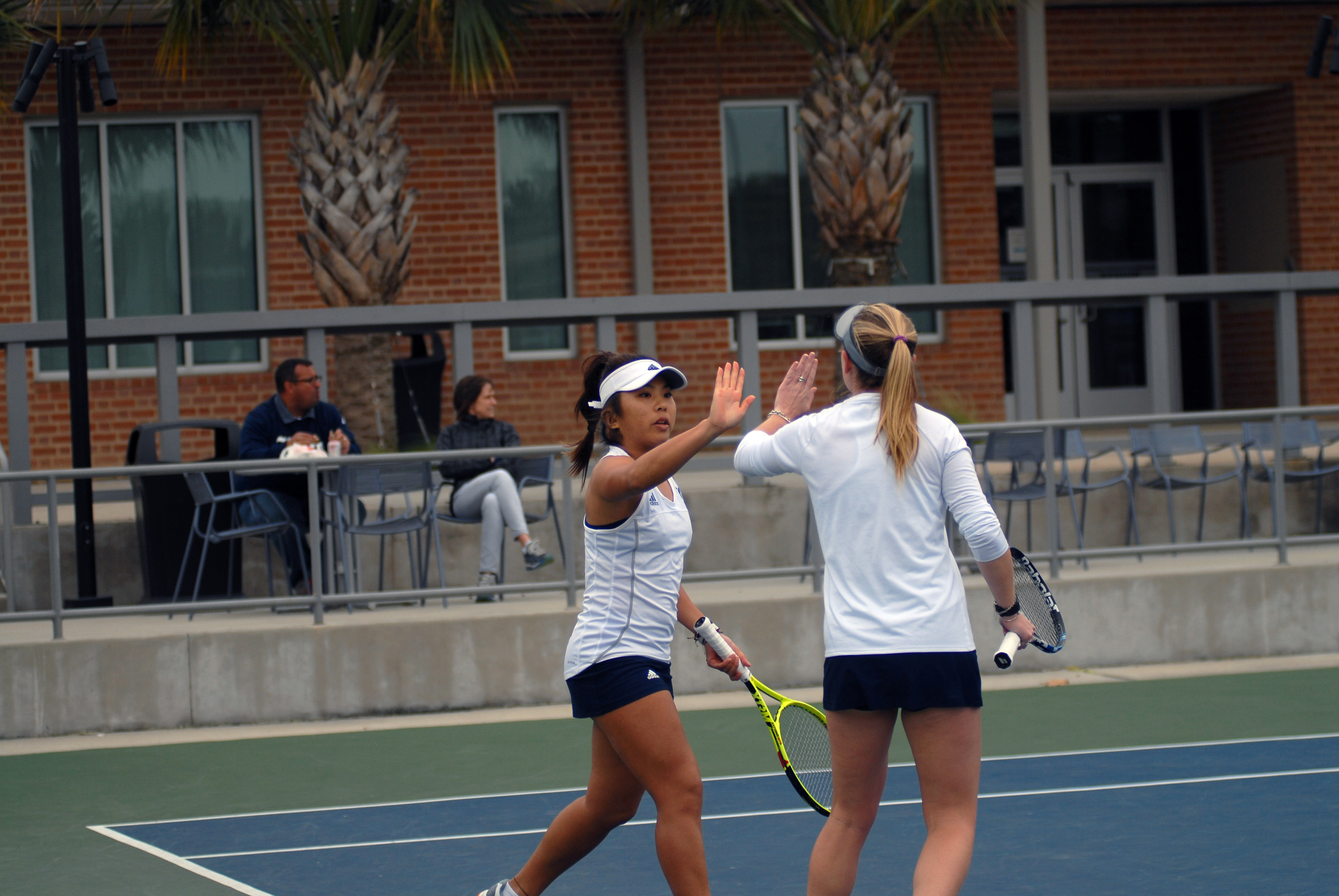 Wendy Zhang and Lindsey Hodge fought back from a late deficit to capture the doubles point for the Owls.