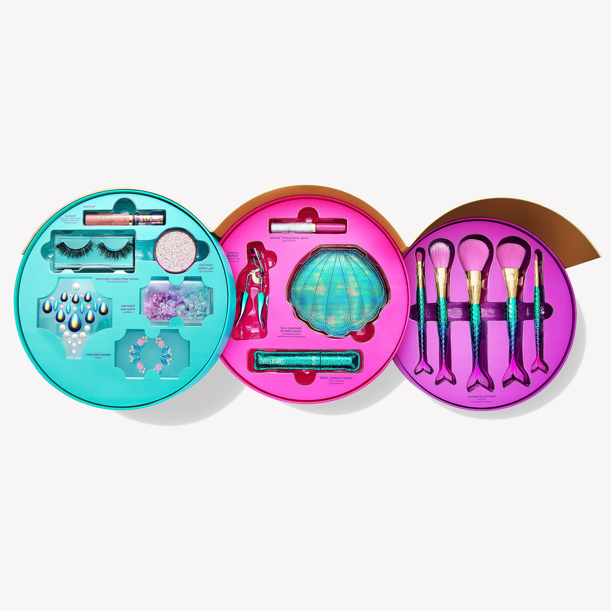 As part of this collection, you'll be able to find the Minutes to Mermaid Brush Set, which features five colorful brushes with handles shaped like mermaid tails; the Mermaid Glitter Gel, which