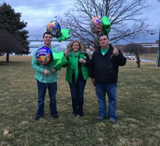 Carter Mears' family holding balloons