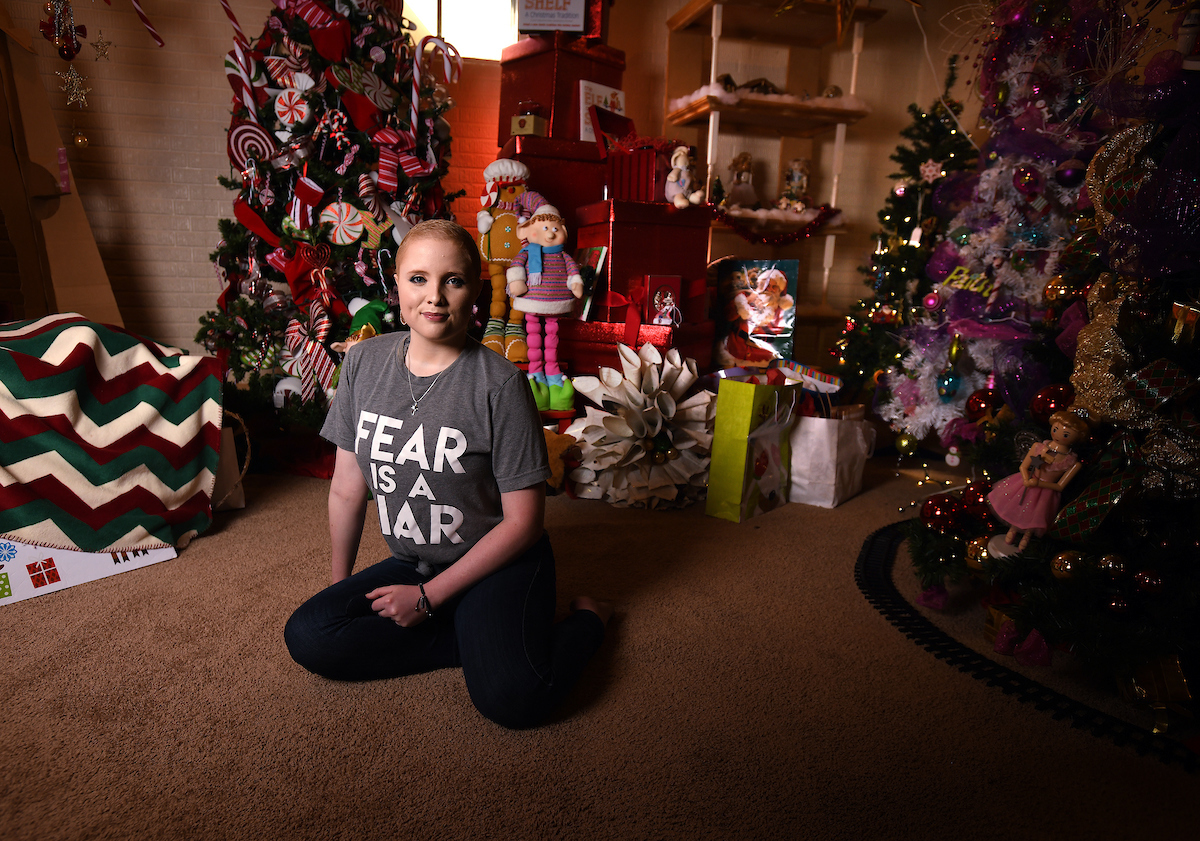 Chaleece Leckron in front of Christmas tree