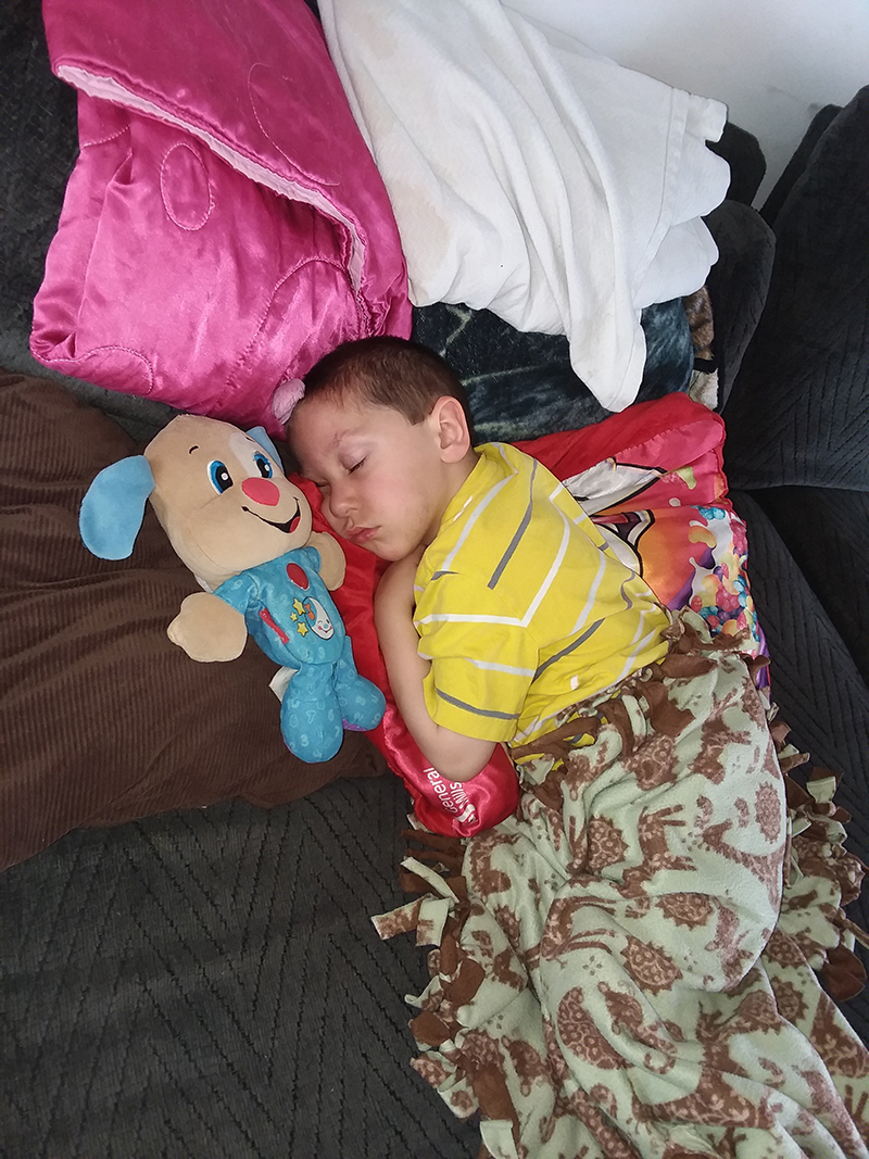 Sammy Curry sleeping with stuffed animal