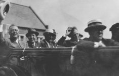 President Franklin Delano Roosevelt waves his hat while riding in a car in visit to Riley. Credit: IUPUI University Library Special Collections and Archives