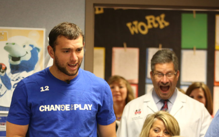 "Indianapolis Colts quarterback Andrew Luck and Riley at IU Health officials surprise winners of the ""Change the Play Challenge."""