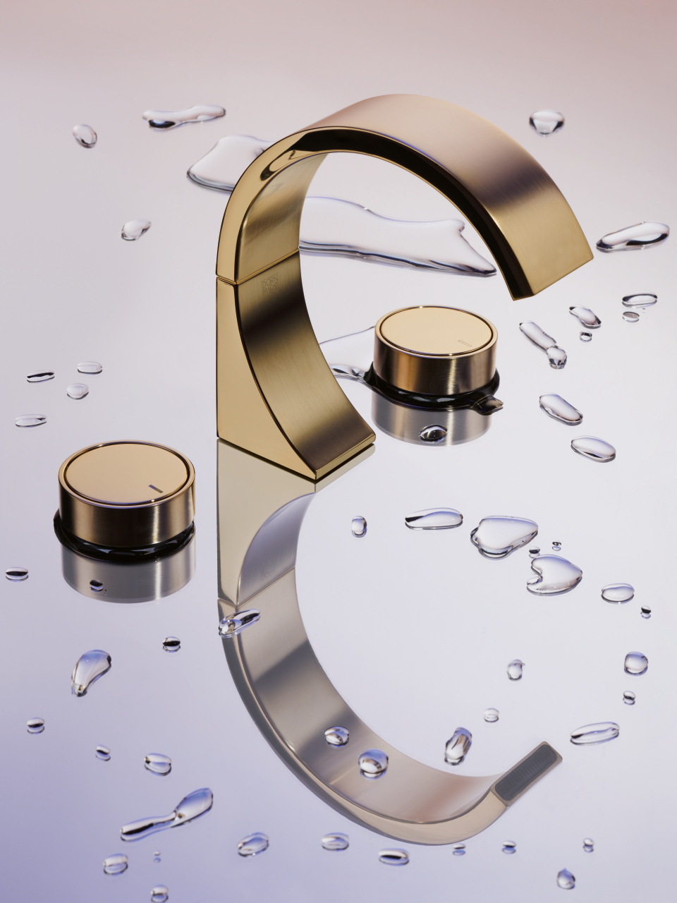 Gold brass Dornbracht faucet CYO collection with drops of water and gold knobs