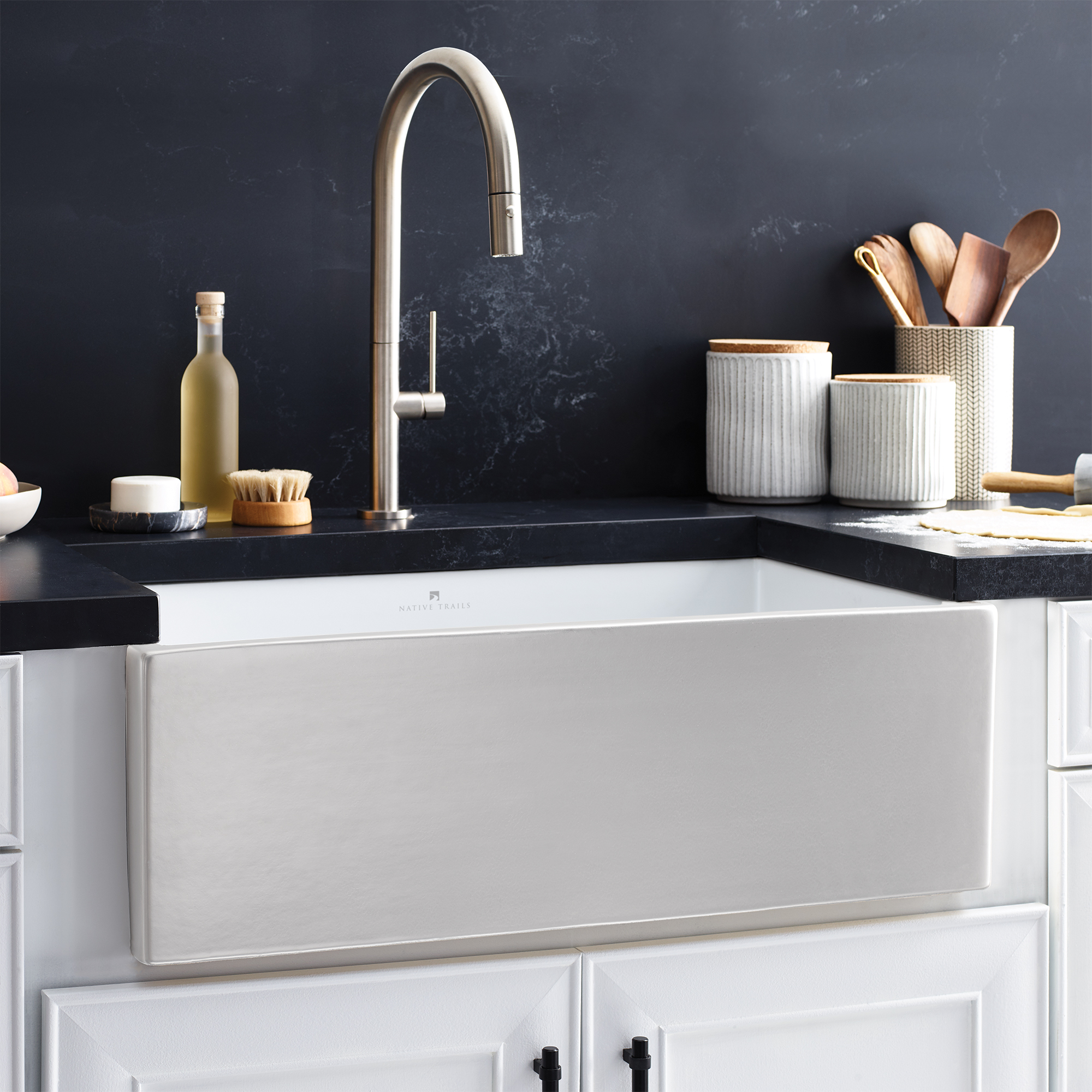 Silver sink by Native Trails Precious Metals Collections with silver bathroom faucet