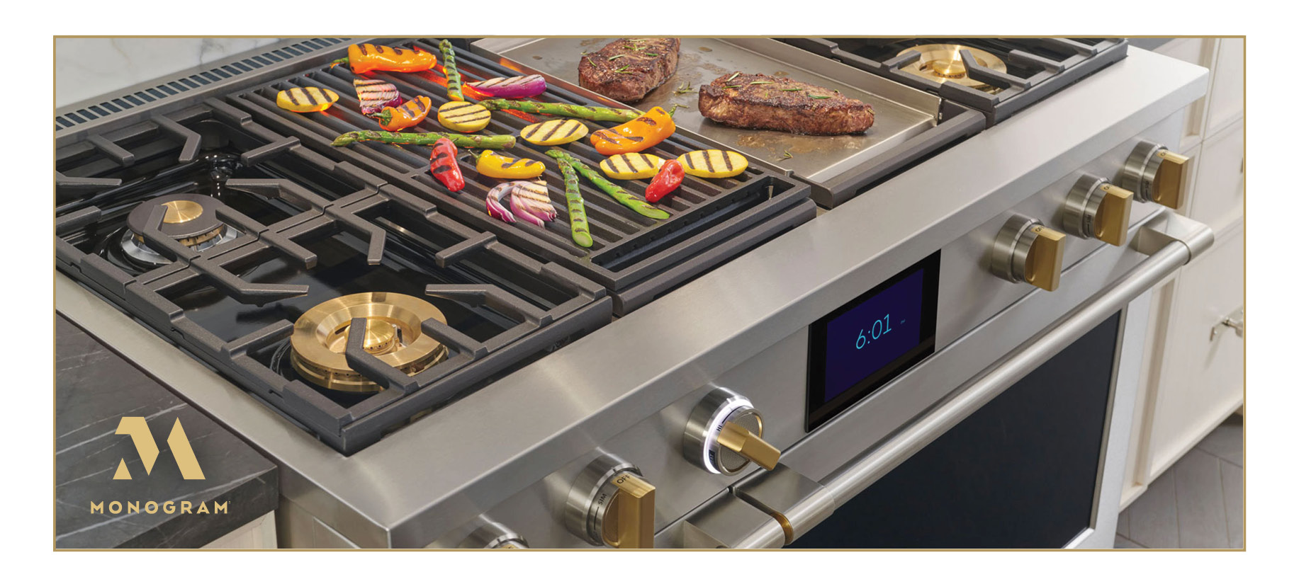 Monogram Professional Range in silver with brass knobs. Steak and vegetables are grilling.
