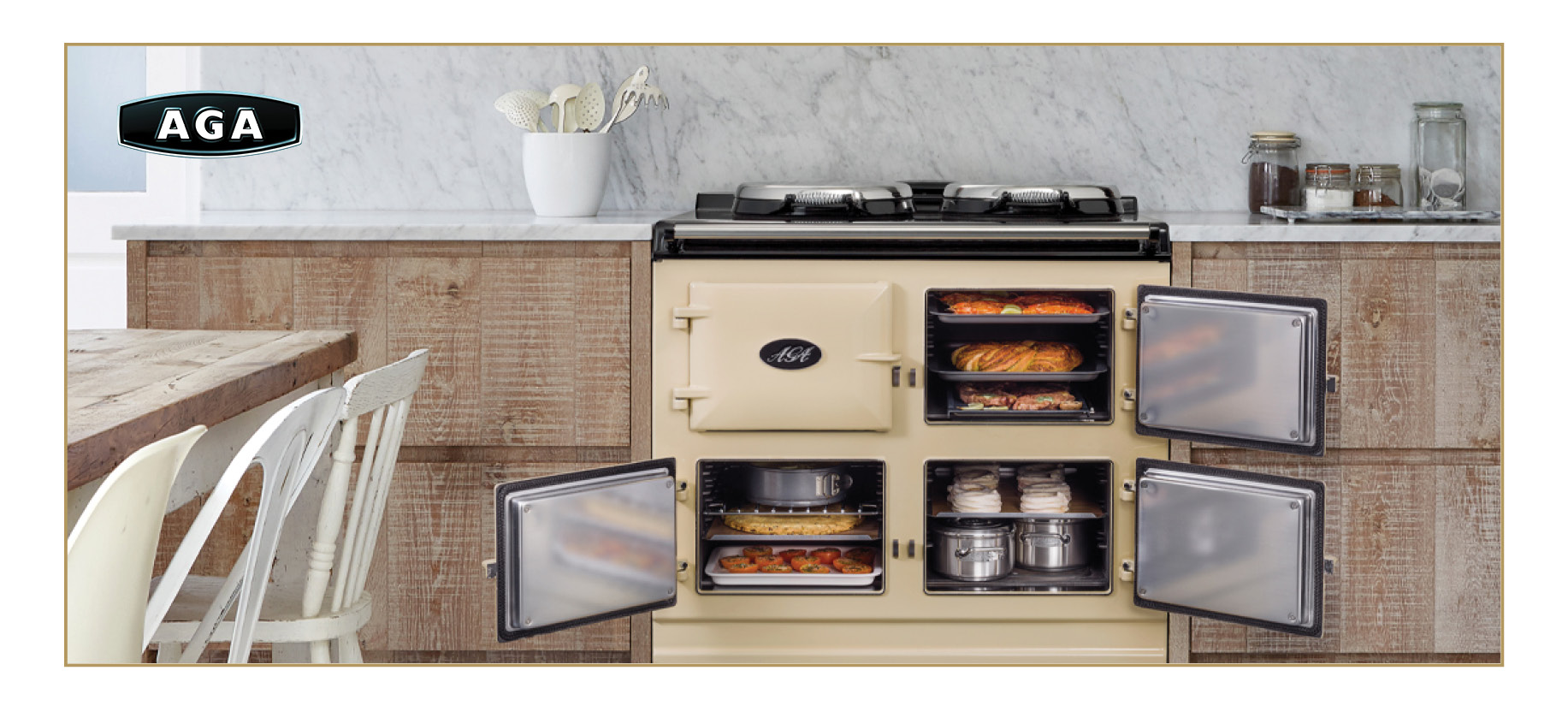 AGA Classic Total Control Range in taupe with four open doors featuring food in the oven.