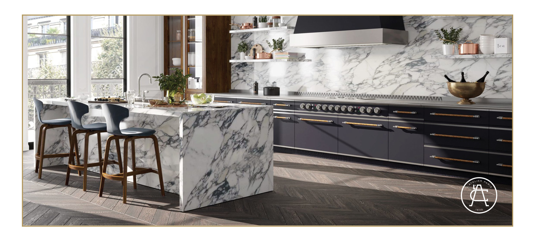 L'Atelier Paris Haute Cuisine La Grande Cuisine Professionnelle in black with brass accents. Range hood in silver and black. Marble kitchen island with chairs.
