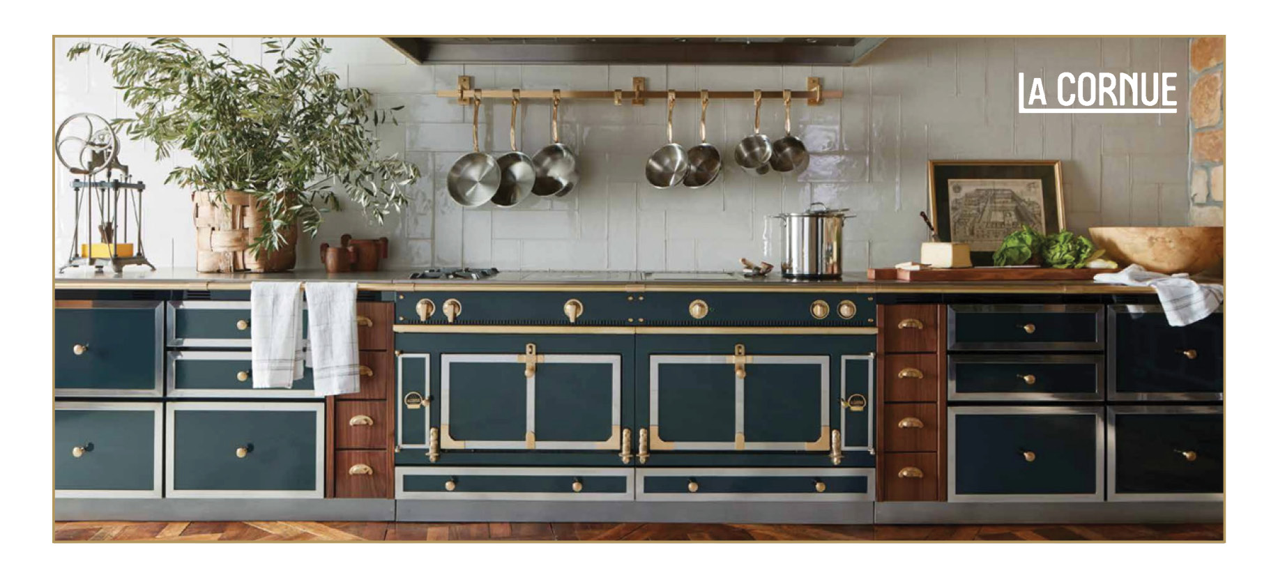 La Cornue CornuFé Range in green and brass. Pots and pans hanging. Food on the counter.