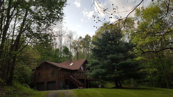 Log Home in beautiful wooded setting