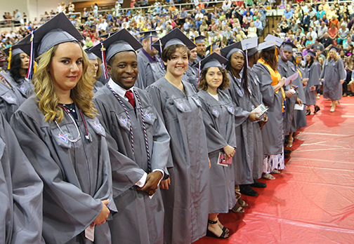 1466173331 graduates in front row for slide