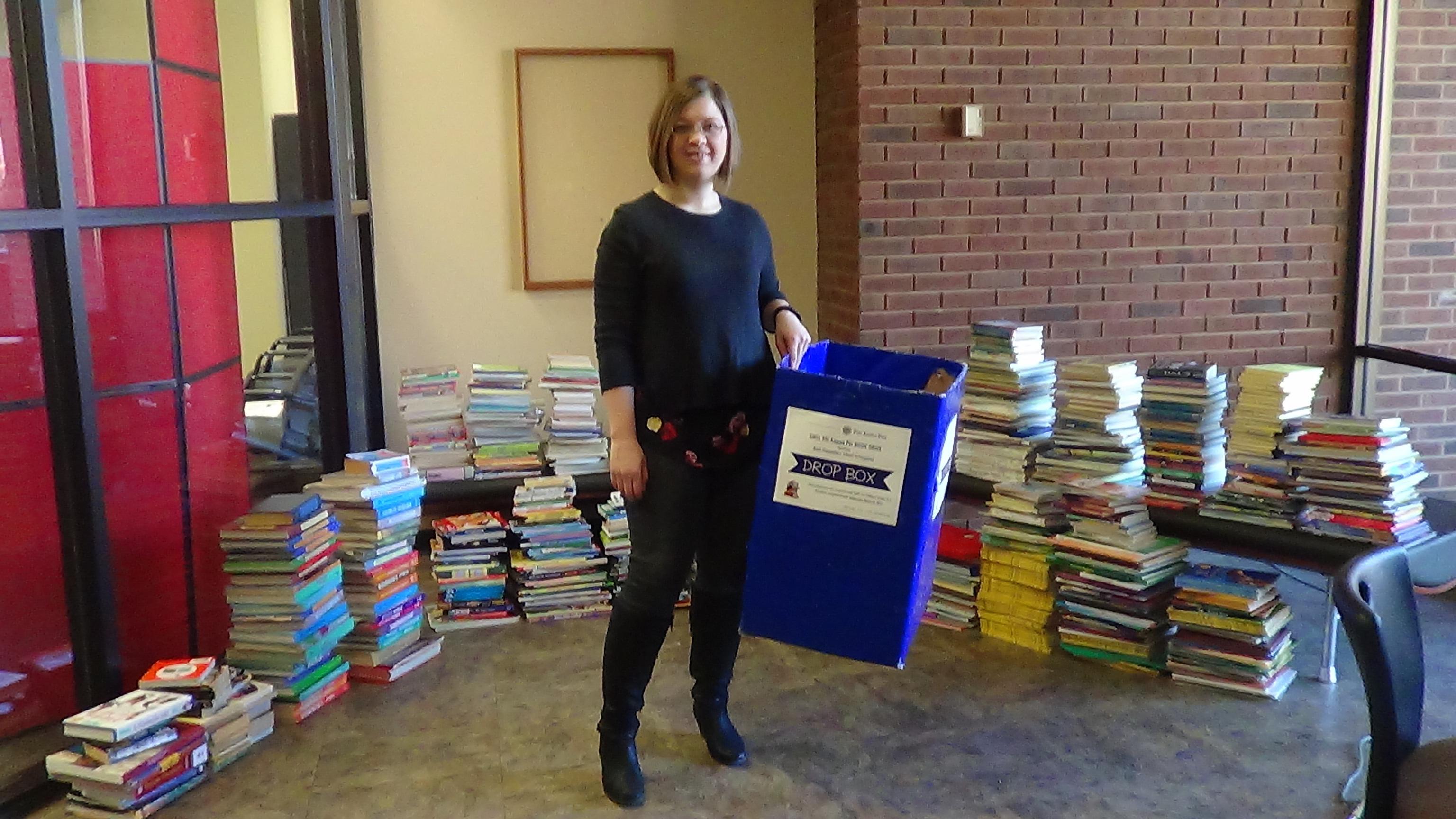 1467142007 ch 227 book drive 2016 amanda rawls with books