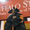 Graduate president embrace
