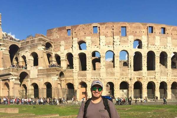 Sanady in front of coliseum