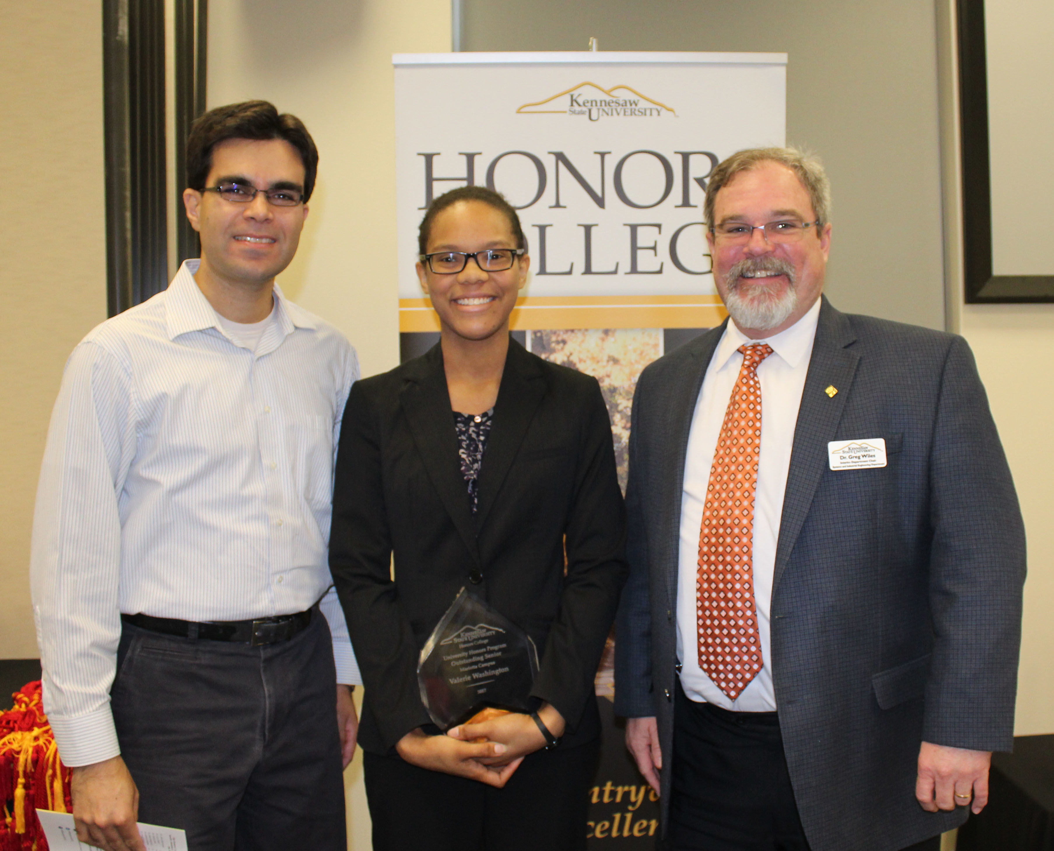 Valerie washington honors award with khalid and wiles