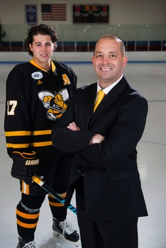 Aic yellow jacket of the year division i mens ice hockey team captain austin orszulak left and head coach eric lang