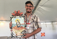 Ethan with award