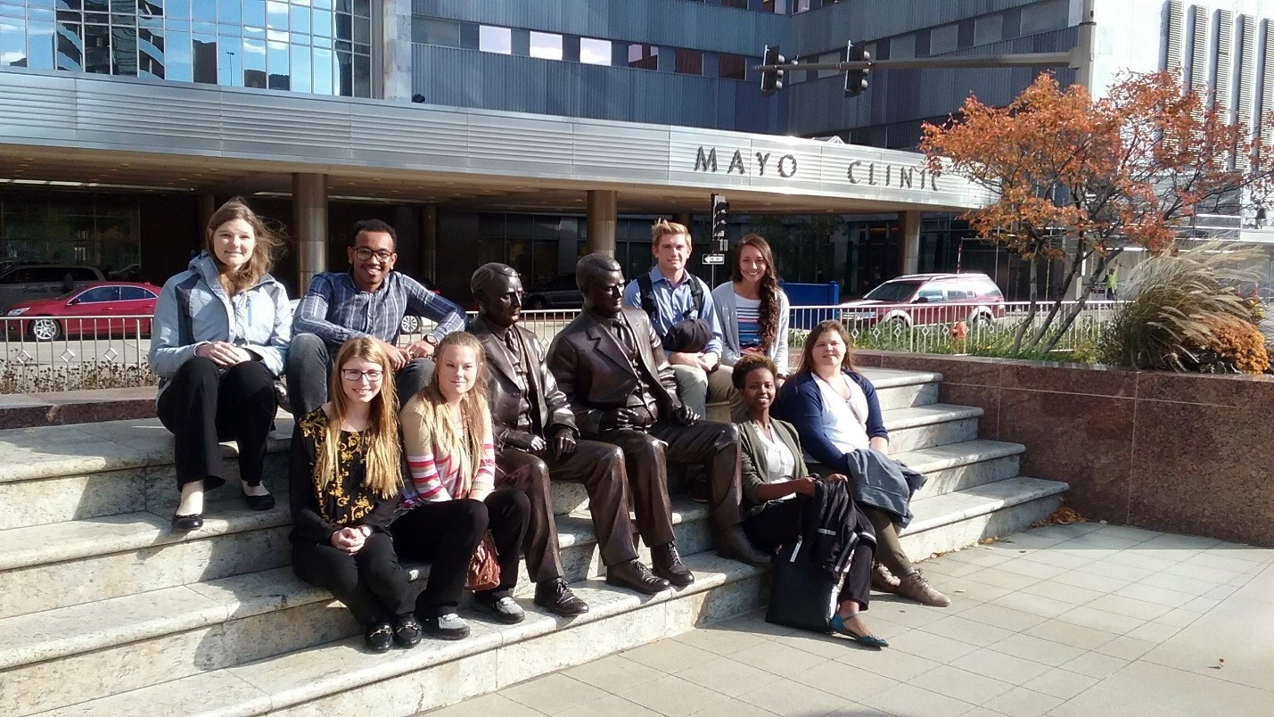 Bvu students at the famous mayo brothers sculpture at the mayo clinic.  top l r kathryn keller kalab kibret derek hunwardsen and emily kim.  bottom l r rachel kehrberg kay wibben nadia ecyomuhendo and amanda miley