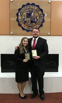 Lindsey mead and jrew brickel with plaques