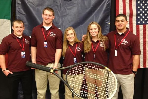 1393337290 au sport management students  pose for a photo prior to the start of the fed cup event in cleveland.