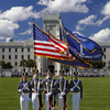 1435266308 american flag on campus with cadets