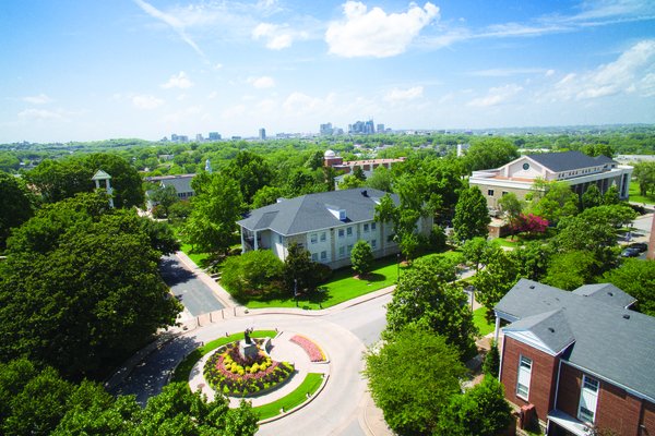 Drone shot of campus inclduing nashville skyline
