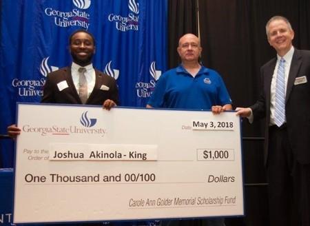 Joshua akinola king scholarship award photo