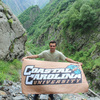 Kevin dispaying ccu banner at gveleti waterfall